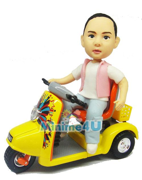 kid ride scooter figurine