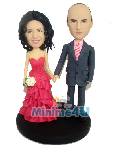 Wedding cake topper with colourful dresses